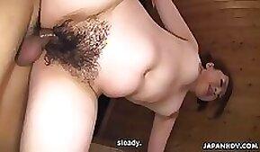 Chubby Japanese girl gives a head in the bathroom